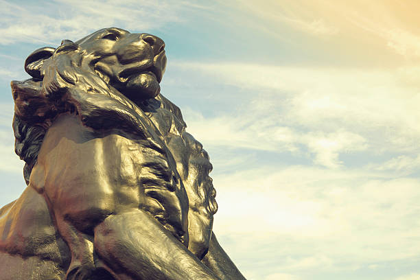 Detail of statue of a king lion Christopher Columbus monument stock photo