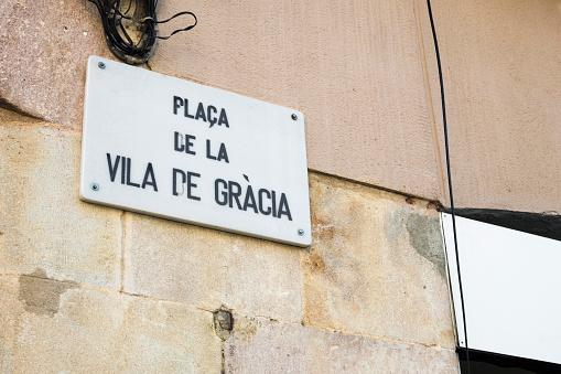 Detail of street sign of Vila de Gracia Square in Barcelona, Spain