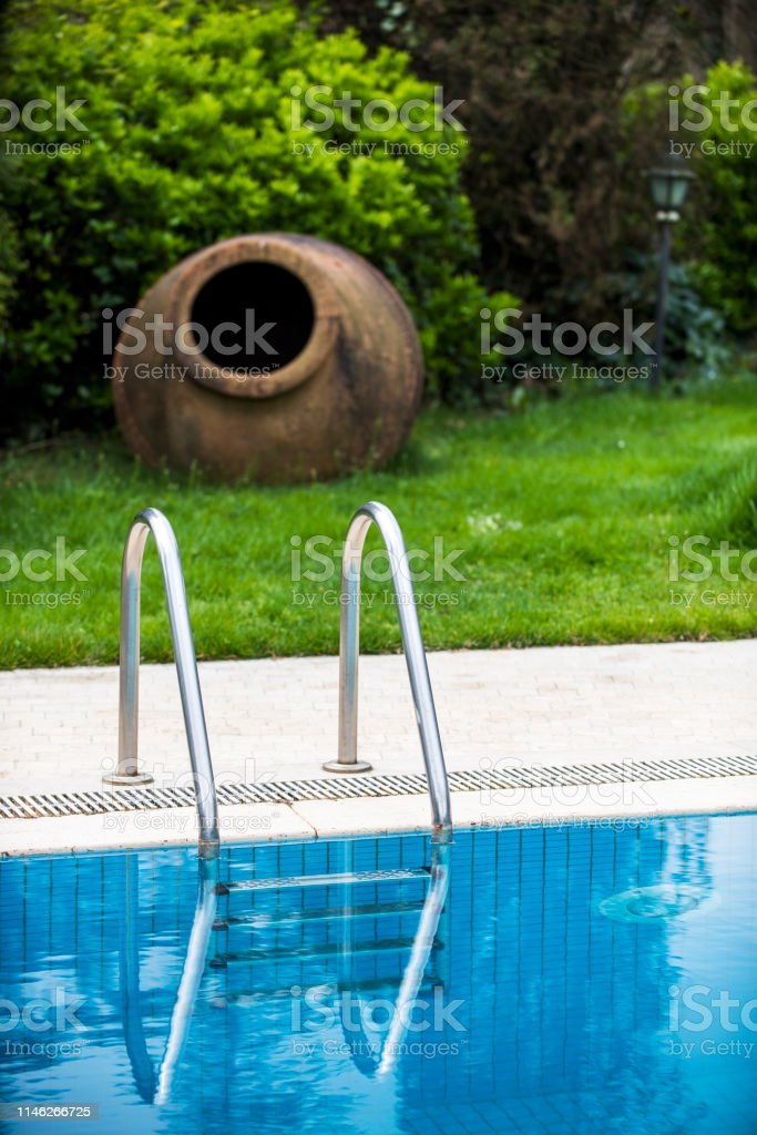 Detail of Swimming Pool in Garden at Springtime.
