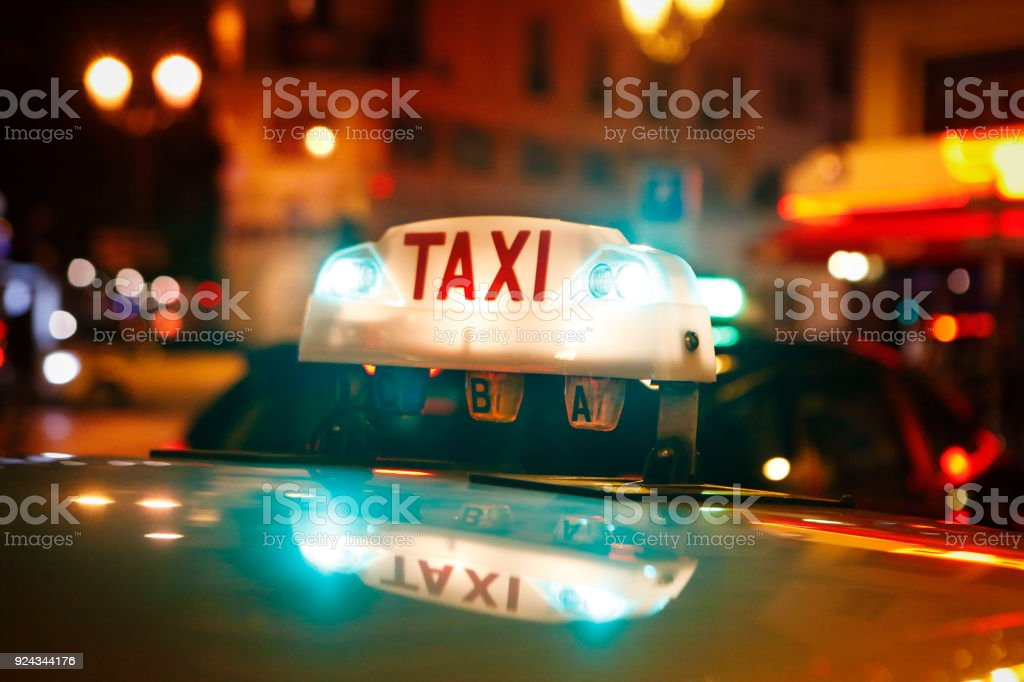 Detail of taxi sign in the city by night stock photo