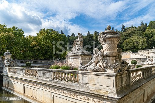 Detail of the beautiful fountain in the Jardin de la fontaine in Nimes, France