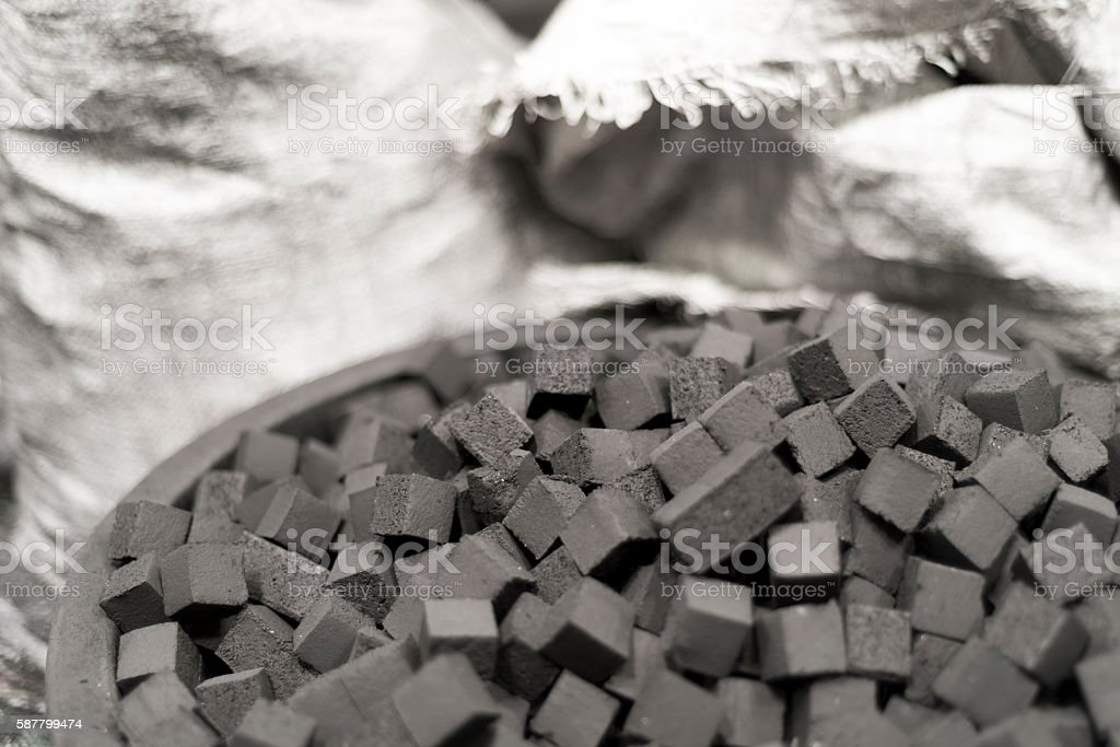 Detail of the bowl of charcoal cubes for hookah stock photo