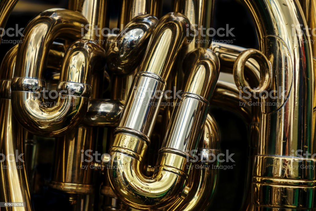 Detail of the brass pipes of a tuba stock photo
