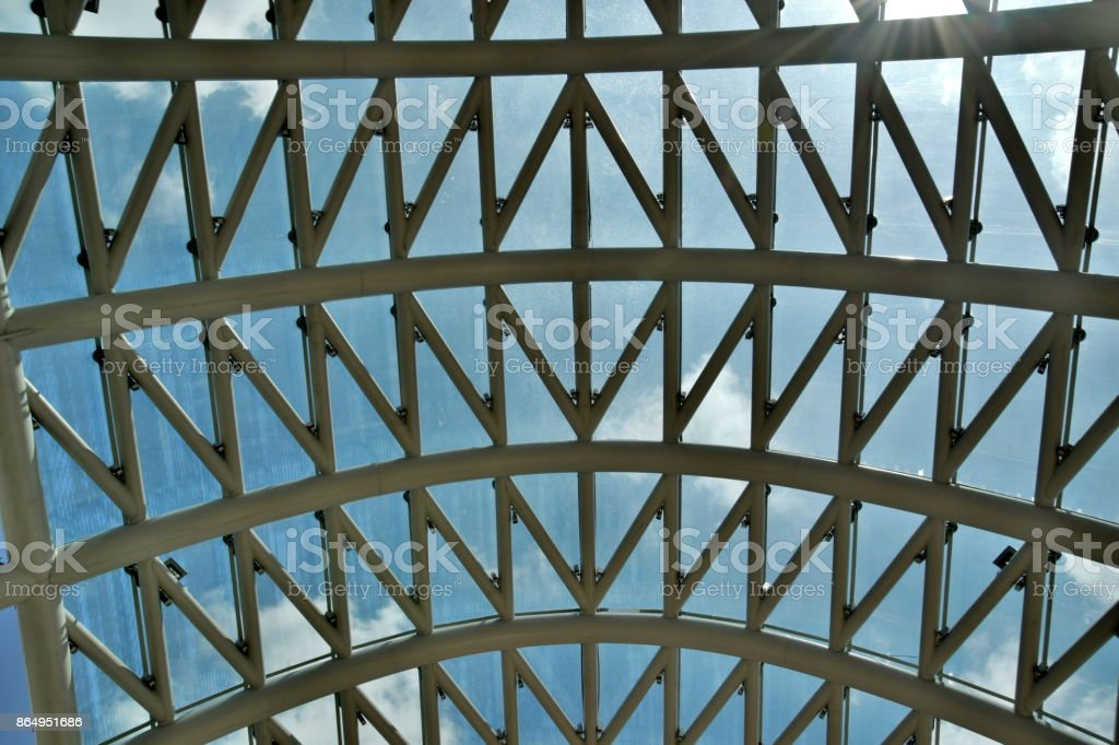 Detail of the Bridge of Peace in Tbilisi, Georgia. White steel and glass structure against the sky. stock photo