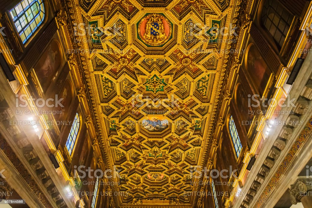 detail of the decorated wooden ceiling of the church of Santa Maria in Trastevere in Rome stock photo