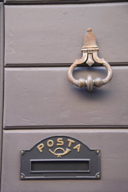 Detail of the door knocker and letter box stock photo