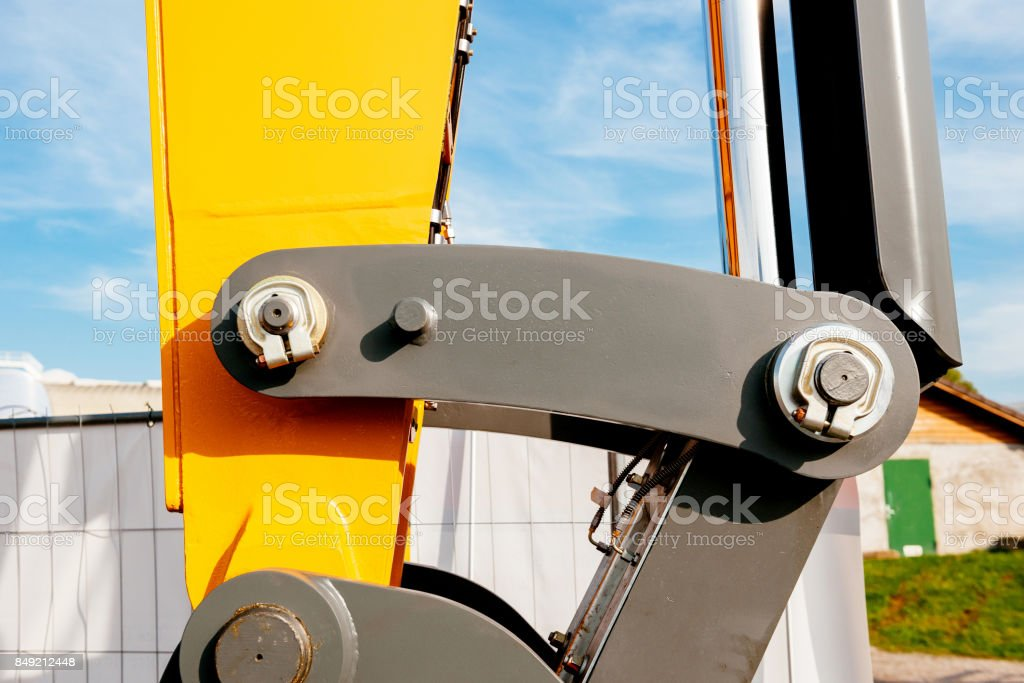 Detail of the industrial part of an hydraulic excavator arm stock photo