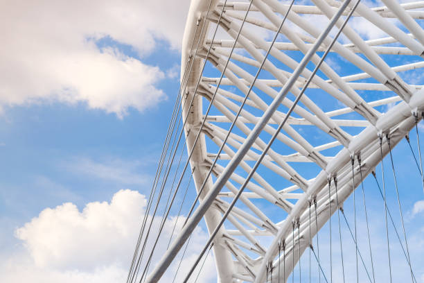 Detail of the iron structure of the modern bridge Settimia Spizzichino in Rome with the sky in the background Detail of the iron structure of the modern bridge Settimia Spizzichino in Rome with the sky in the background man made structure stock pictures, royalty-free photos & images