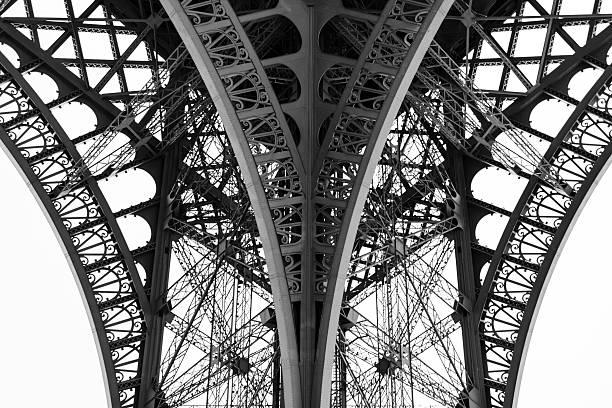 detail of the legs of the eiffel tower, paris, france. - boog architectonisch element stockfoto's en -beelden