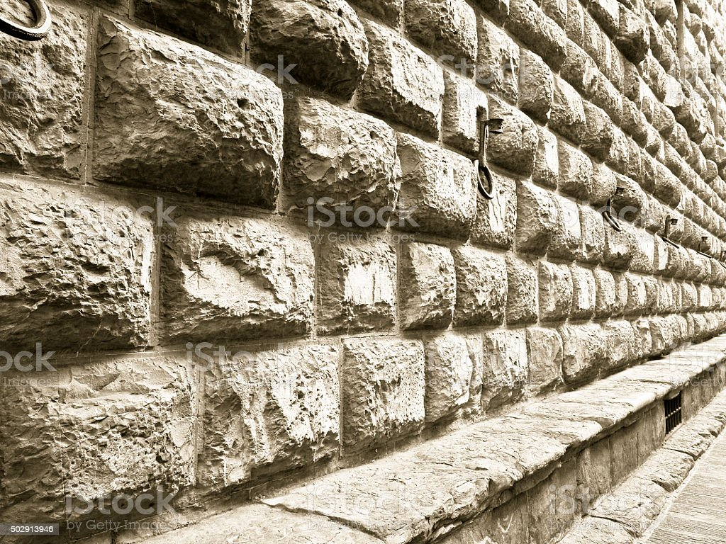 Detail of the Medici Riccardi's Palace stone wall stock photo