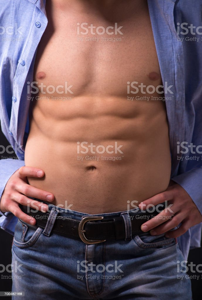 Detail Of The Muscular Mans Body Showing His Ripped Abdomen Muscles ...