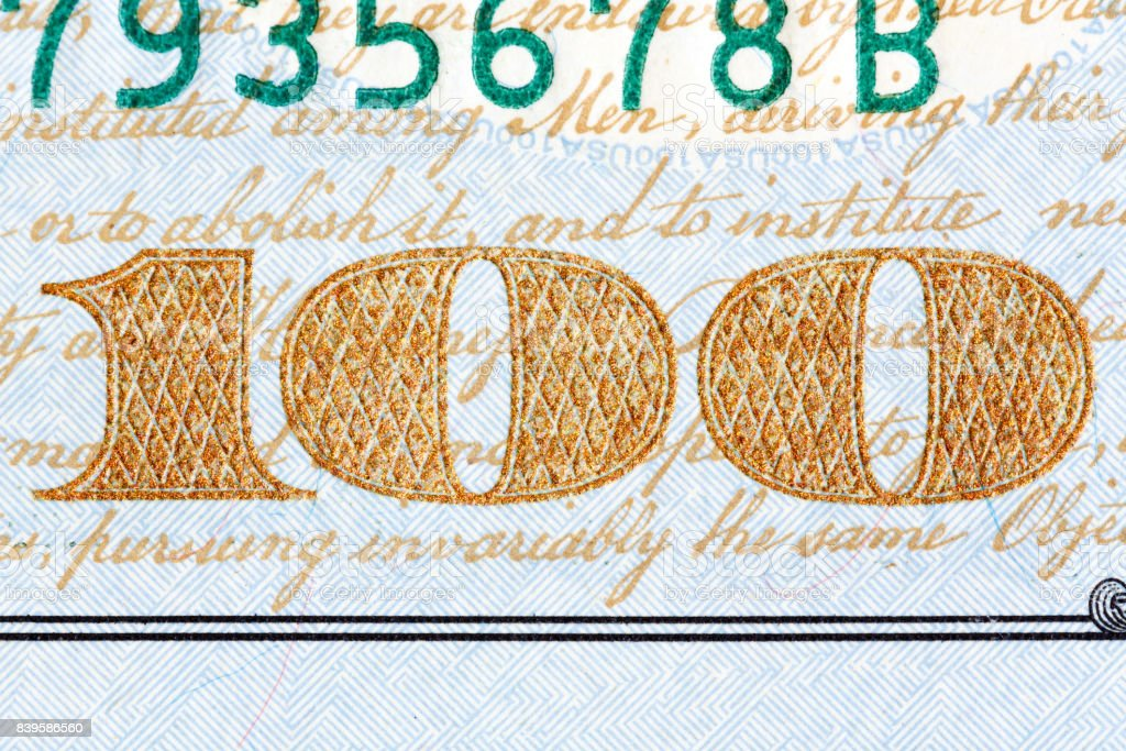 Detail of the newly design U.S. one hundred dollar bill stock photo