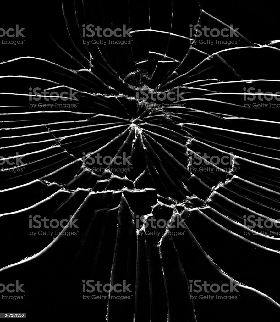 Detail of the shattered glass - cracks and shards stock photo