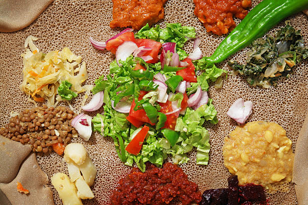 detail of traditional ethiopian injera meal - eritrea stock photos and pictures