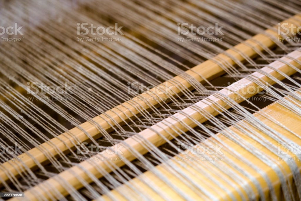 detail of traditional loom used for weaving stock photo