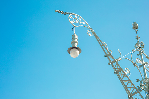 Detail of traditional streetlight or lamp on a sunny day near Arch of Triumph in Barcelona, Spain