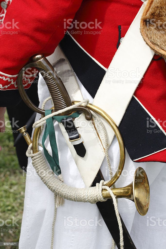 Detail of trumpet and sword royalty-free stock photo