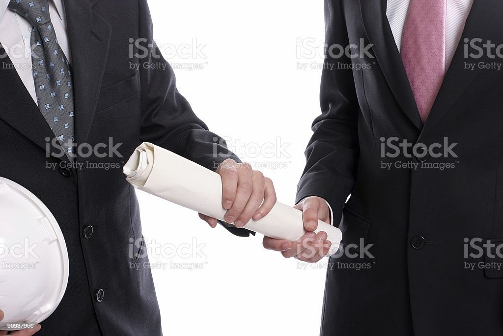 detail of two business exchanging a new project royalty-free stock photo