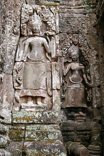 Detail of two sculptures in a temple at Angkor, Cambodia