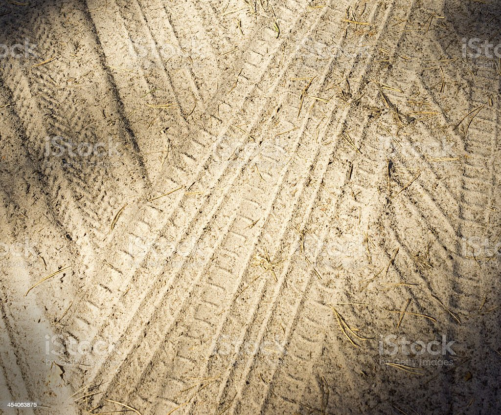 Detail of tyre tracks in sand royalty-free stock photo