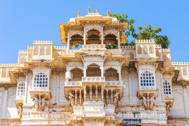 Detail of Udaipur city palace. UDAIPUR, RAJASTHAN, INDIA- FEB 24, 2018 : Towers and terraces of Amar Vilas (hanging garden) of Udaipur city palace from outside. udaipur stock pictures, royalty-free photos & images