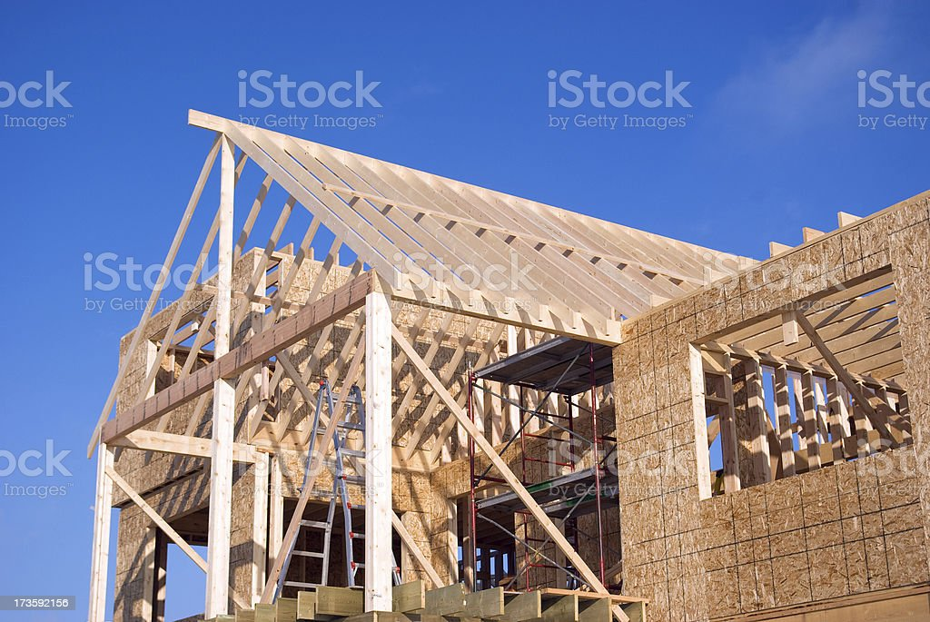 Detail of unfinished  house with wood framing. royalty-free stock photo