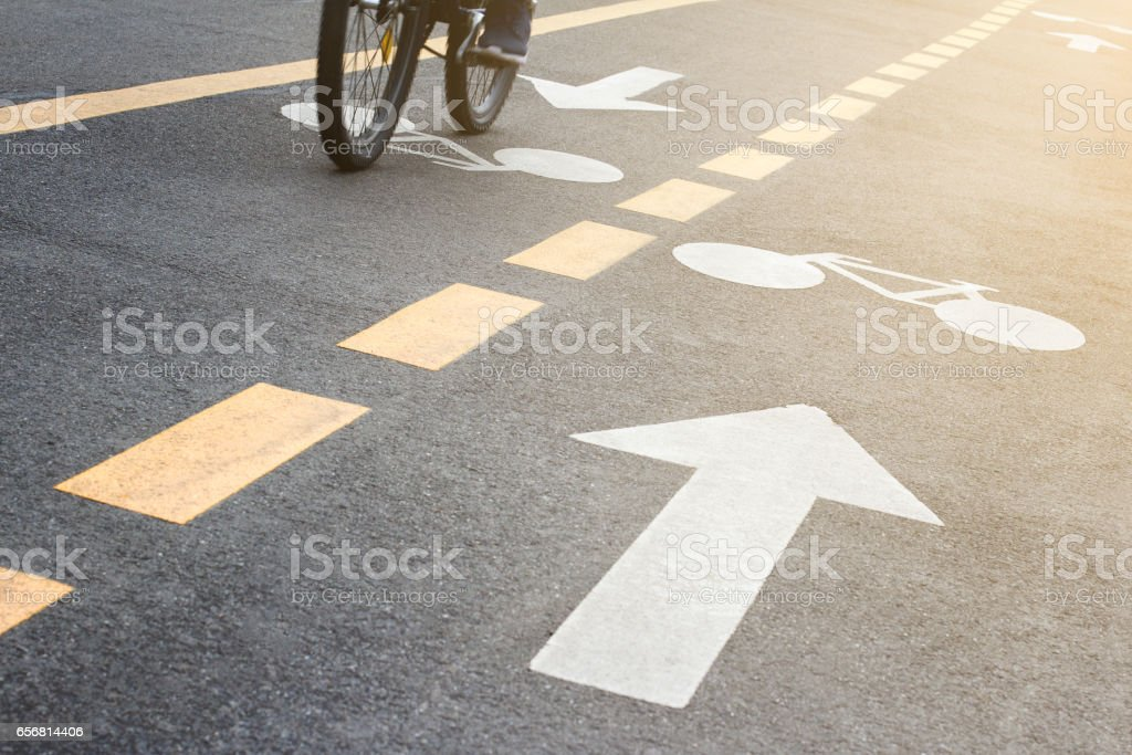 detail of urban bicycle track with biker coming stock photo