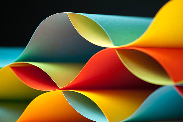 detail of waved colored paper structure - symmetry stock photos and pictures