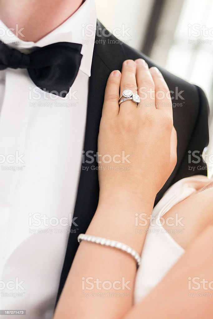 Detail of Wedding Ring with Bride And Groom royalty-free stock photo