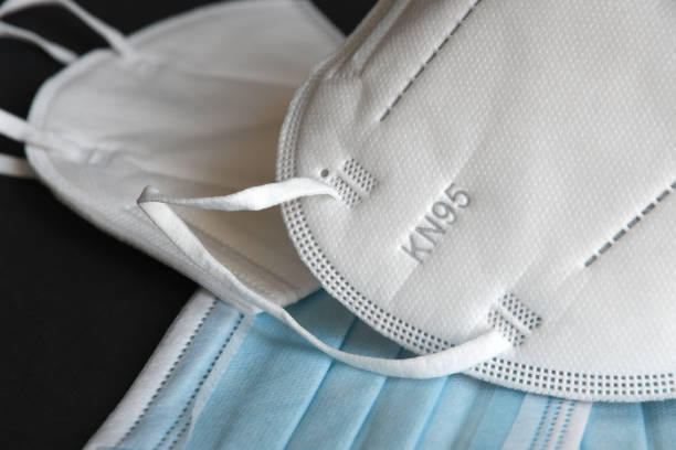 detail of white medical mask ffp2 kn95 with antiviral medical mask for protection against coronavirus. surgical protective mask. prevention of the spread of virus and pandemic covid-19. - ffp2 imagens e fotografias de stock