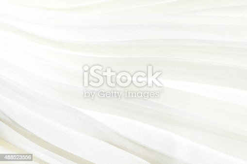 istock Detail of white pleated skirt. White cloth background pleated 488523556