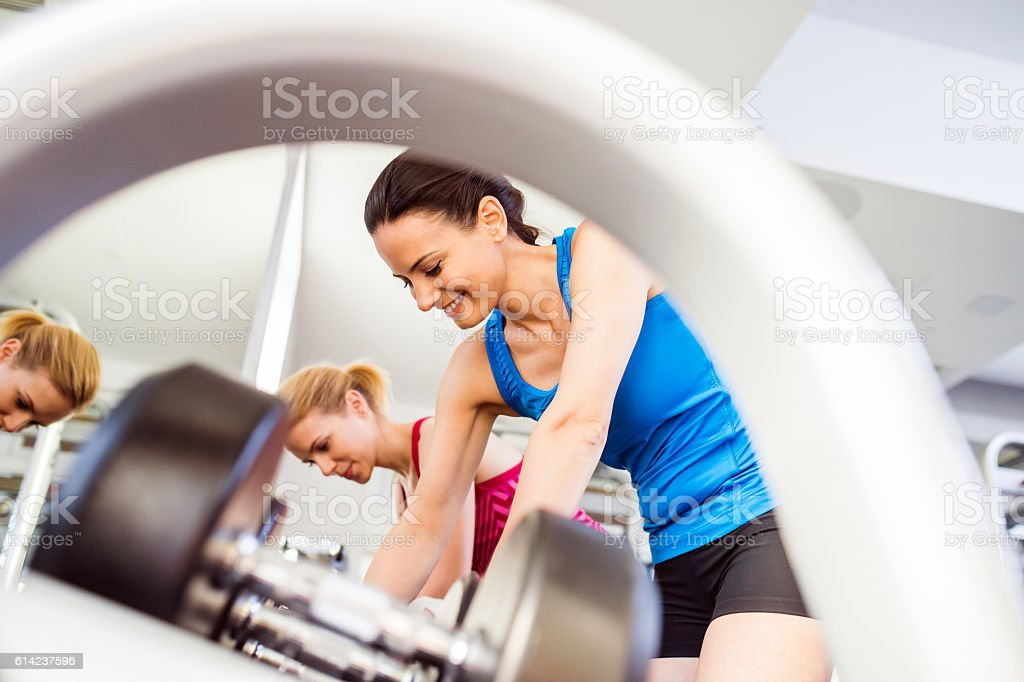Detail of women in gym working out with weights royalty-free stock photo