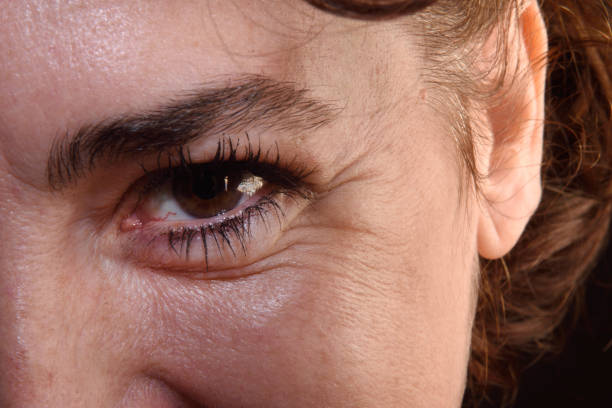 Detail of wrinkles in a woman's eyes stock photo