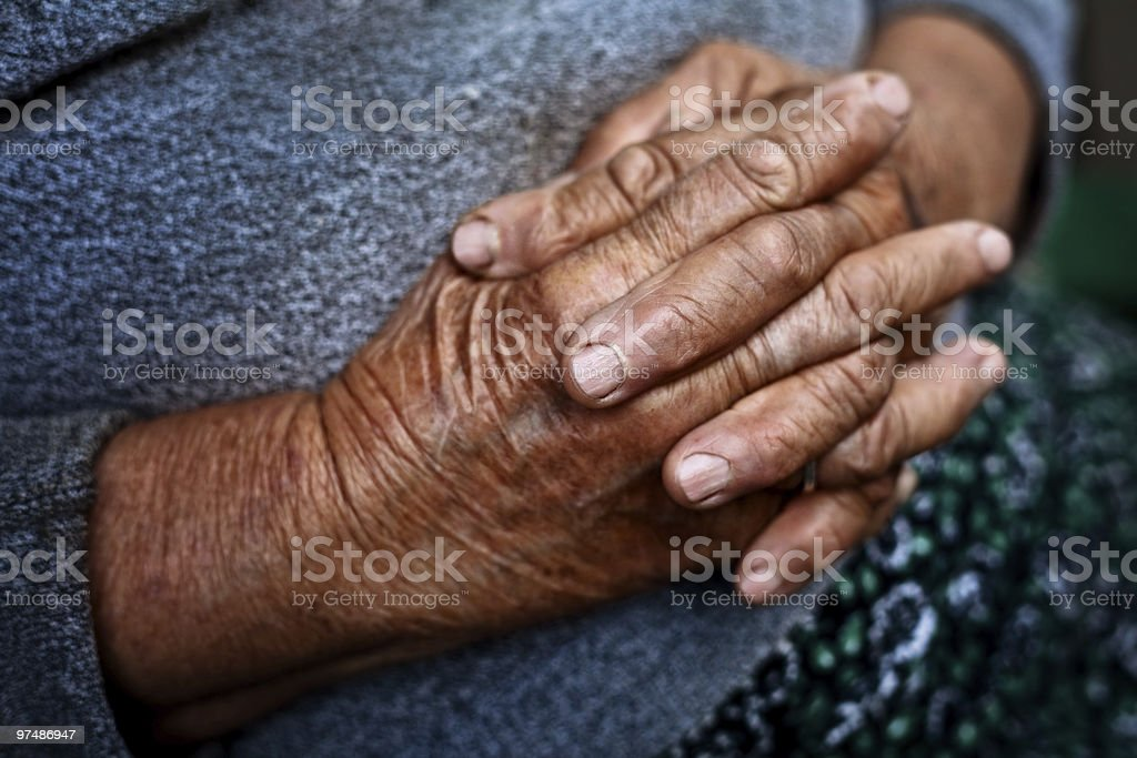 Detail on old hands of senior wrinkled woman royalty-free stock photo