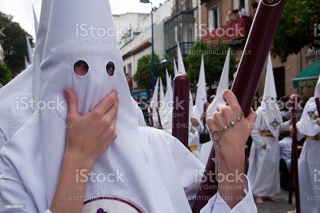 Detail penitent red holding a candle during Holy Week royalty-free stock photo