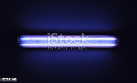 istock Detail shot of a fluorescent light tube on a wall. 527891166