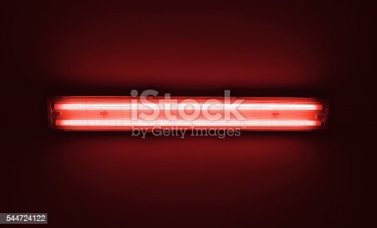 istock Detail shot of a fluorescent light tube on a wall. 544724122