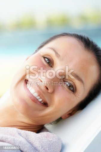 istock Detail shot of a relaxed beautiful woman smiling 183306820