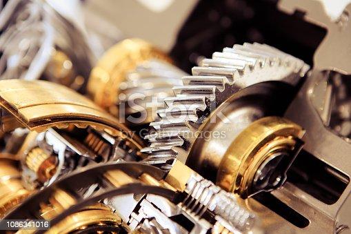 Detail shot of cogwheels in gear.Circle, Engine, Gear, Machine Part, Metal,