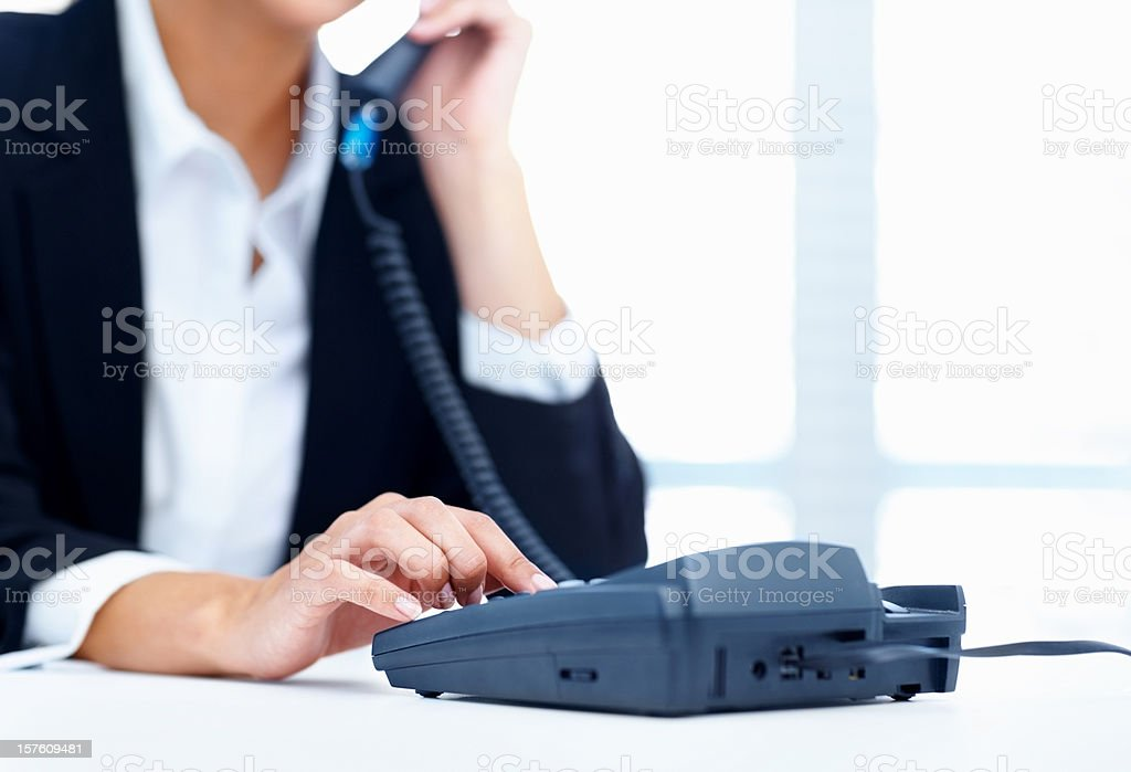 Detail view of a secretary making phone call stock photo