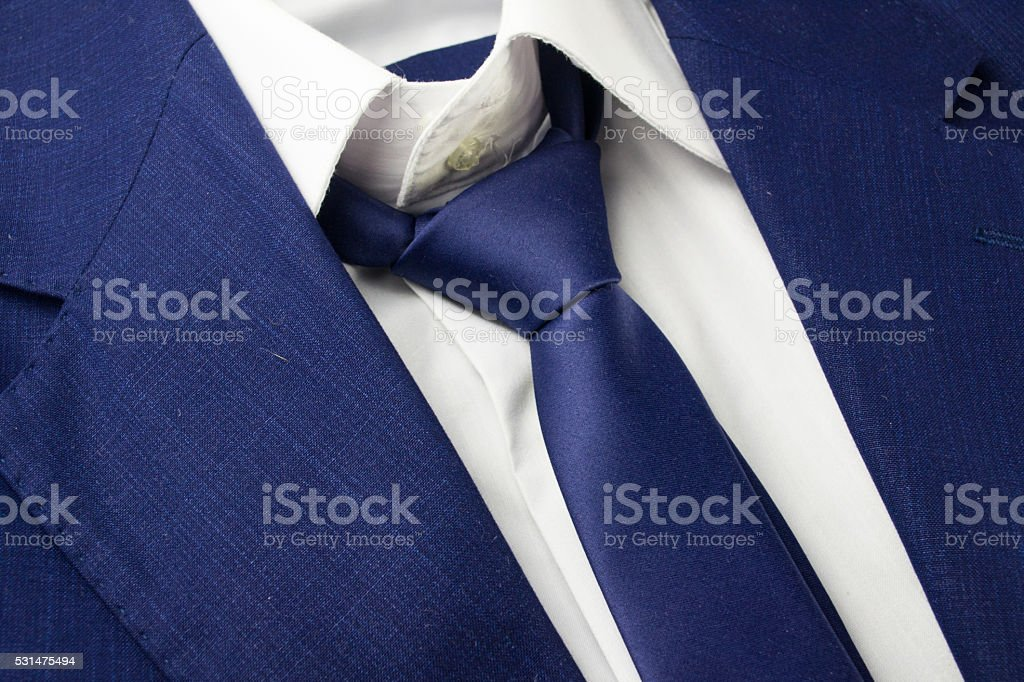 Detail view of business blue suit with tie stock photo