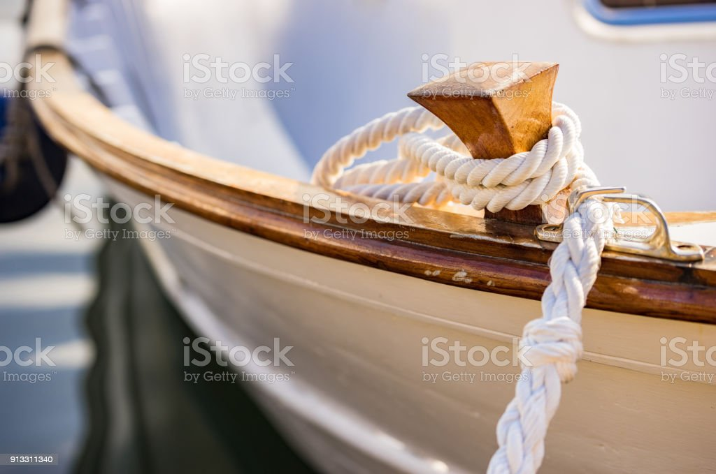 Detail view of rope cleat on boat deck stock photo