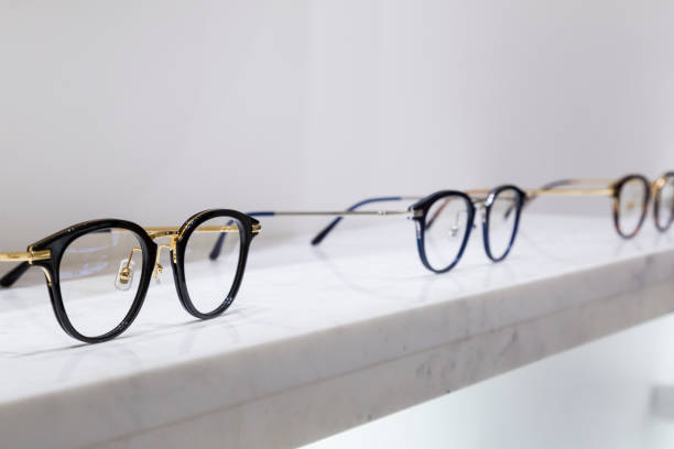 detail view of various eyeglasses lying on a tray stock photo