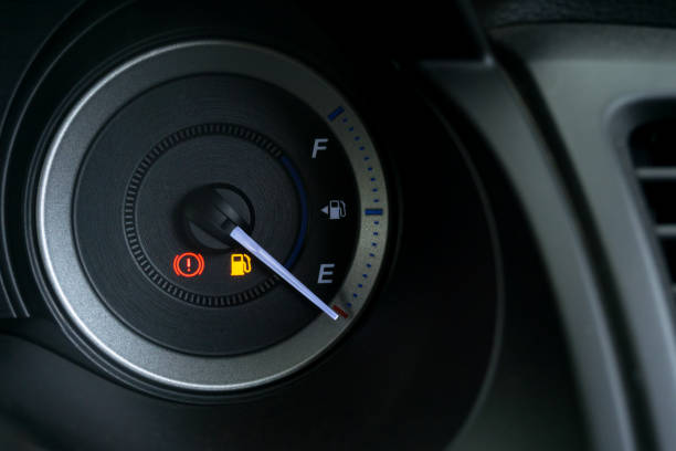 Detail with the fuel gauges showing and empty tank on dashboard stock photo