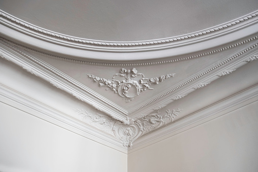 Close up shot of the corner of a ceiling in a luxurious Paris apartment.
