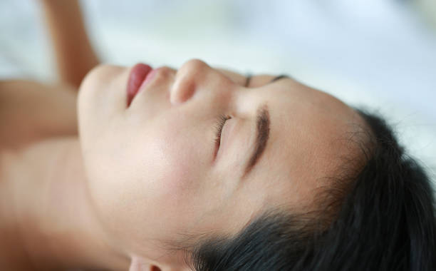 Detailed close up of woman face lying on the bed. stock photo