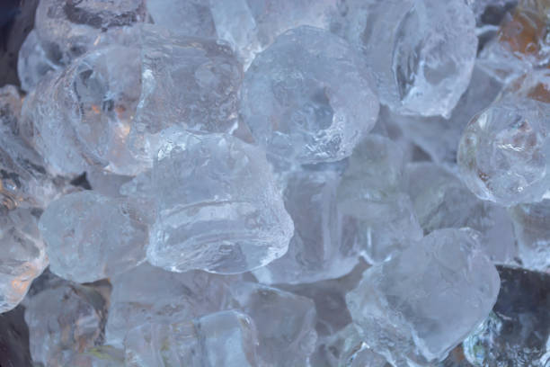 detailed ,close up view of ice cubes to defrost, effect of shadows, sunlight - defrost stock pictures, royalty-free photos & images