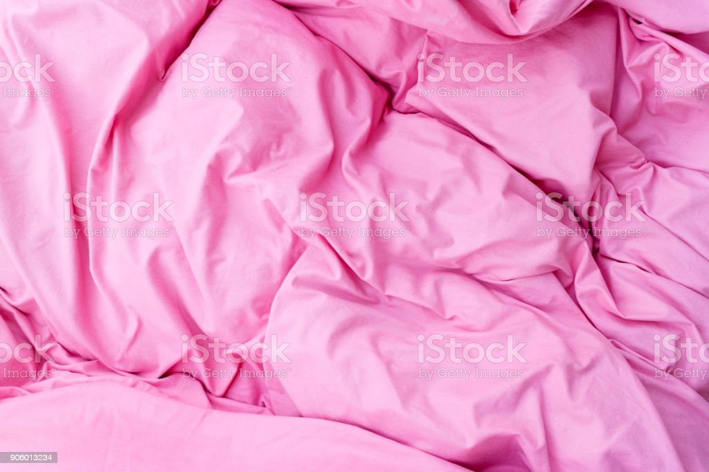 Fabric textures and patterns concept. Detailed closeup of pink...