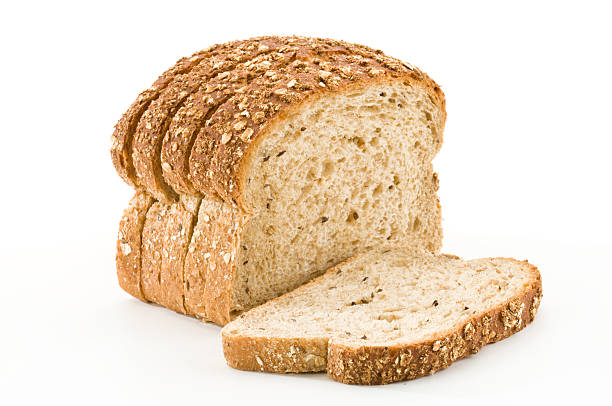 Detailed close-up of sliced grain bread on white background Sliced Bread on White Backgroundhttp://i1215.photobucket.com/albums/cc503/carlosgawronski/FoodonWhite.jpg bread stock pictures, royalty-free photos & images