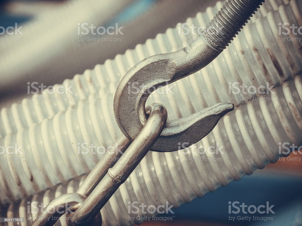 Machines, production concept. Detailed closeup of steel metal hook...
